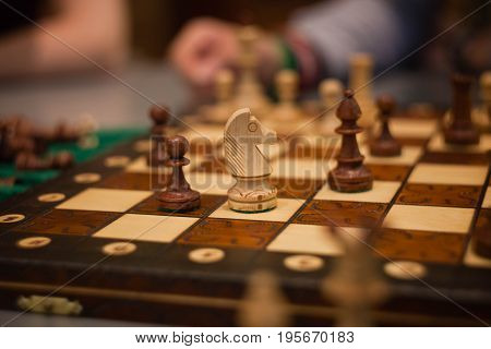 wood chess pieces on board game. vintage background