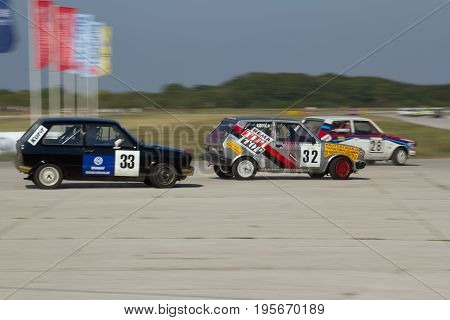 BELGRADE, SERBIA - September 24, 2011: Car racing championship EKO NAGRADA 2011, three Yugo 55 cars near the curve, motion blurred background