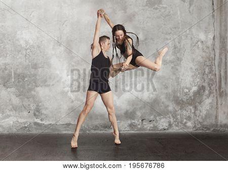 Pair of dancing contemporary dance in black body