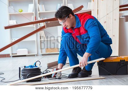 Young carpenter working with wooden planks