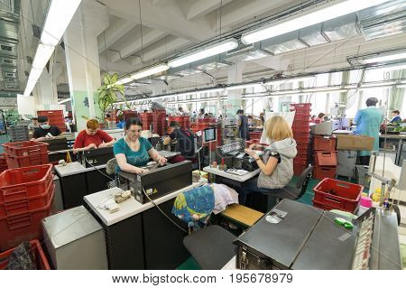 Shoe Factory. Female Worker On A Sewing Machine.