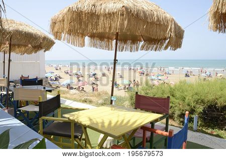 CHIPIONA, SPAIN - JULY 16, 2017: Terrace at beach restaurant with views to the Atlantic Ocean located in Chipiona a municipality of the province of Cadiz Andalusia Spain