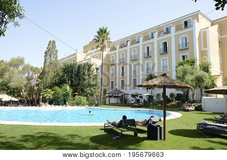 JEREZ, SPAIN - JULY 16, 2017: Swimming pool at the gardens of Montecastillo Hotel Jerez Andalusia Spain.