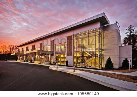 Generic Modern Stylish Office Executive Retail Building Exterior With Stone and Metal walls and Large Glass Windows And Brick Accents