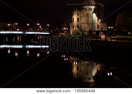 Atomic Dome near Ota River in Hiroshima Peace Memorial Park, Japan at night