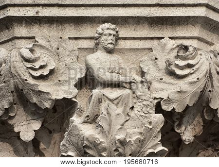 Hercules fight with Nemean Lion symbolizes strength ancient medieval relief on Venice Doge Palace column