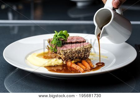 medium done grilled tuna steak in batter served with the baby carrot and mashpotato