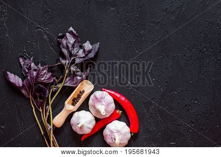Cook workplace. Vegetables on black table background top view.