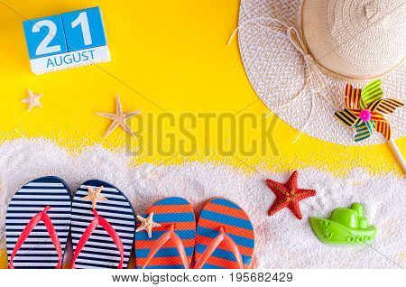 August 21st. Image of august 21 calendar with summer beach accessories and traveler outfit on background. Summer day, Vacation concept.