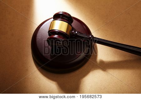 high angle of gavel hammer on the brown table