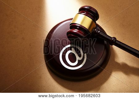gavel hammer with the at sign or internet law