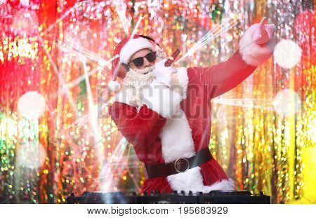 Santa Claus performing in nightclub at Christmas party