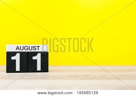 August 11th. Image of august 11, calendar on yellow background with empty space for text. Summer time.