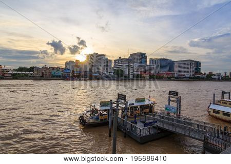 Bangkok , Thailand - 14 July, 2017 : People transport by ferry at Tha Maharaj port for crossing the Chao Phraya river in Bangkok