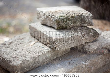 Old blocks of concrete. Very shallow depth of fileld selective focus.