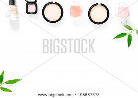 Makeup kit. Eyeshadows, blushes on white table background top view.
