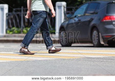 Close Up Of Person Walking On Street