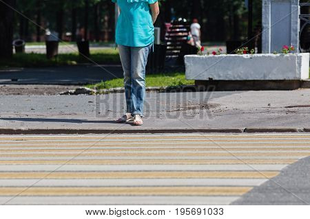 Closeup Of Young Woman Legs Waiting At Crosswalk.