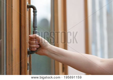 Woman Reaching To Open A Door To An Office