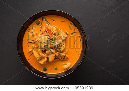 Thai style Red curry with Beef menu or Thai name is panaeng neur. Beef menu with coconut milk.Panaeng Curry with Pork on Wooden table