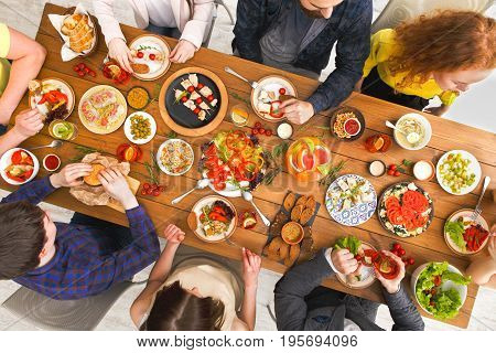 People eat healthy meals at served table dinner party, table top view