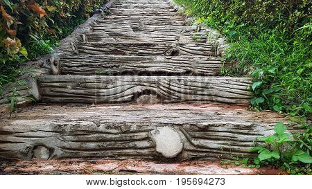 Concrete stairs decorated to look like wood in public park.