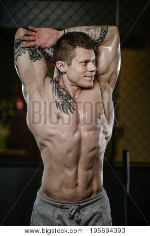 Strong And Handsome Athletic Young Tattoo Man With Muscles