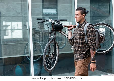 Young Cyclist Man With Glasses Carries Bicycle On His Shoulder Lifestyle Daily Routine Concept