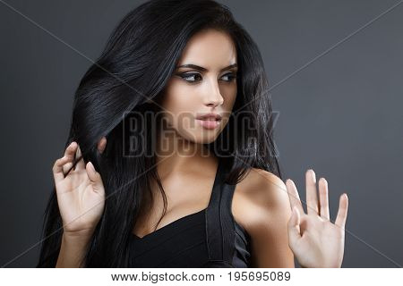 Beautiful Model Girl With Smooth Dark Hair. Perfect Hair. Black Dress.