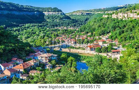 VELIKO TARNOVO BULGARIA - JULY 06 2012: Panoramic view on a clear summer day on the hills of Trapezitsa and Tsarevets and the Yantra river in the ancient capital of Bulgaria Veliko Tarnovo.