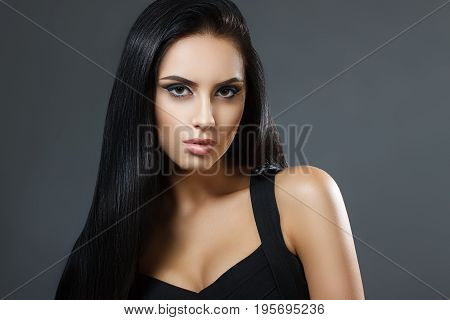 Beautiful Model Girl With Smooth Dark Hair. Perfect Hair. Black Dress