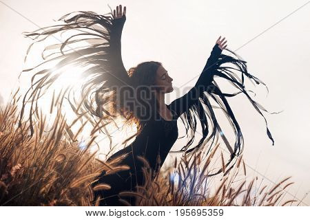 beautiful woman silhouette. wings and freedom concept