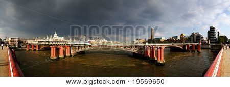 Panoramic view of London skyline and the river Thames with storm clouds brooding
