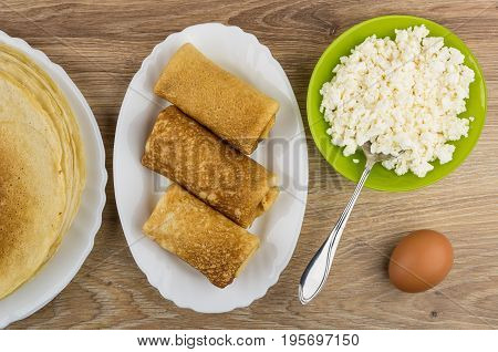 Cottage Cheese In Bowl, Prepared Pancakes In Dish And Egg