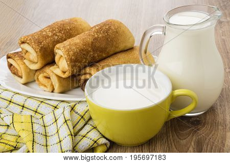 Fried Pancakes With Stuffed In Dish, Jug Of Milk