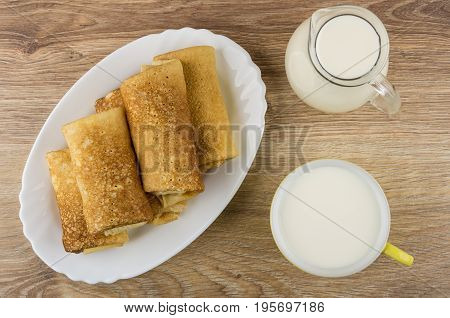 Heap Of Pancakes With Stuffed In Dish, Jug Of Milk