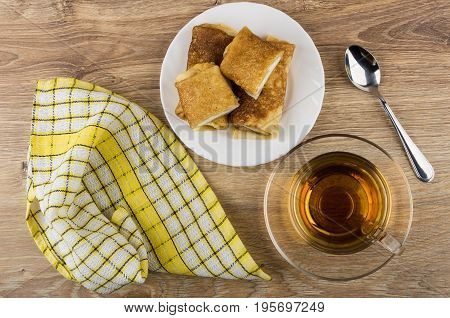 Pancakes With Cottage Cheese In Plate, Cup Of Tea, Napkin