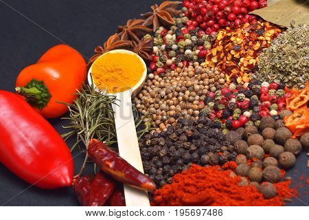 Composition with different spices and herbs.  Cooking ingredients.
