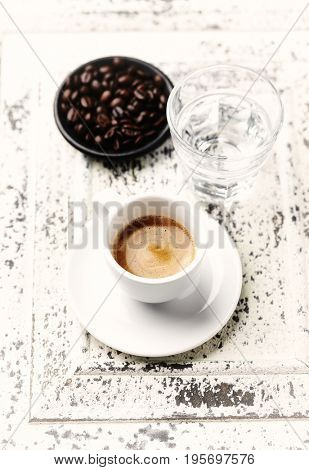 Cup of Espresso on a Rustic Wooden Background