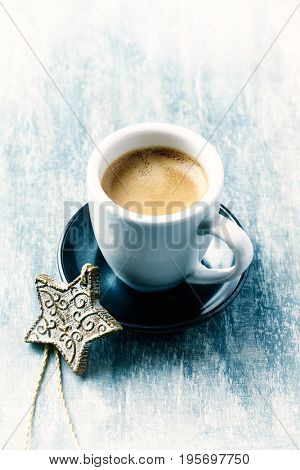 Cup of Coffee and a Christmas decoration