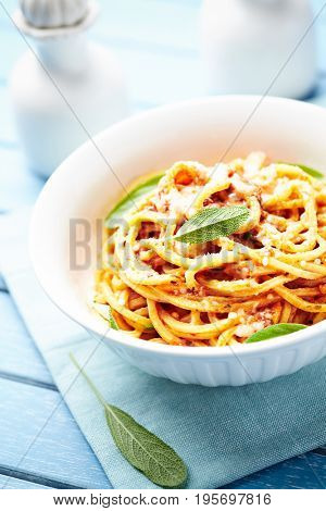 Spaghetti with vegan Bolognese sauce and fresh sage