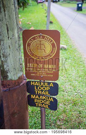 HAUULA, HI - FEBRUARY 25, 2017: Sign for the State of Hawaii natural area hikes Hauula Loop and the Maakua Ridge Trail in Oahu Hawaii.
