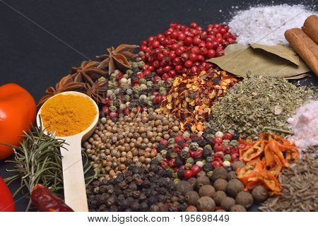 Composition with different spices and herbs.  Cooking ingredients on wood background.