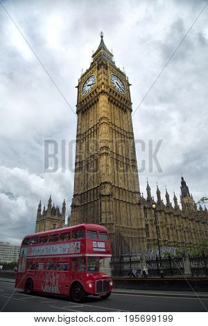 LONDON, UK - MAY 29, 2017:  Red vintage bus in front of Big Ben, nickname of the Great Bell of the clock at the north end of the Palace of Westminster in London