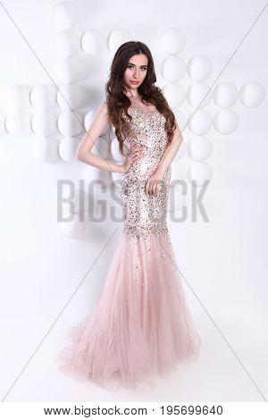 beautiful young woman wearing long dress