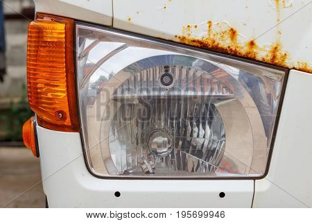 Headlight Of A Old Truck Closeup. Front View