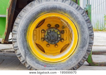 Front Wheel Of Old Forklift Truck Closeup