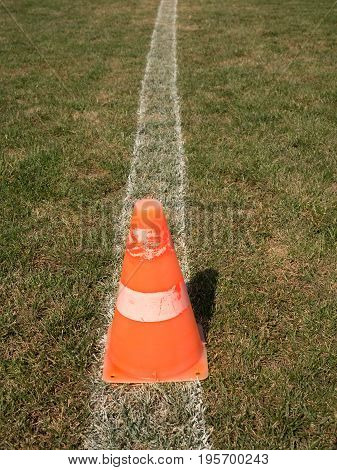 Bright Orange White Plastic Cone On Painted White Line. Very Dry  Football Playground