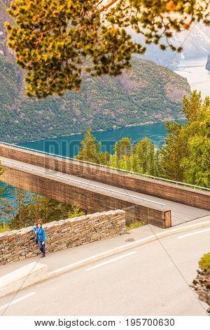 Tourist Woman On Stegastein Viewpoint Norway