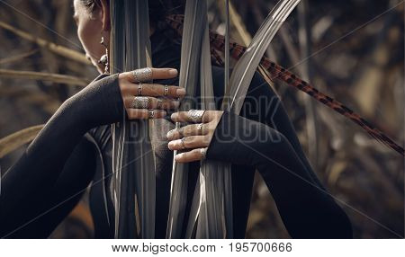 close up of mystery woman hands outdoors